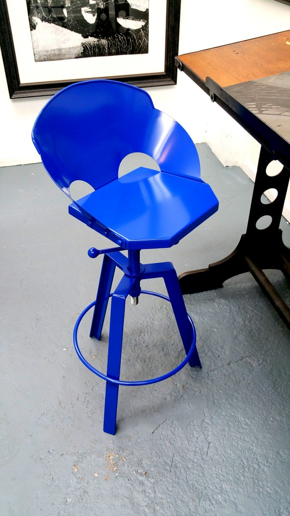 Beaten black and blue handmade industrial steel stool, in blue